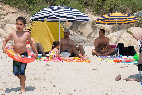 Mohammed and Sophie's family beach parasol setup next too our parasol.  The French know how to relax on the beach.