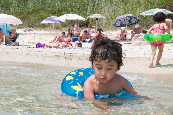 Jaden at plage de l'Escalet, a pretty little beach nestled in between 2 rocky points with soft sand a beautiful blue water.