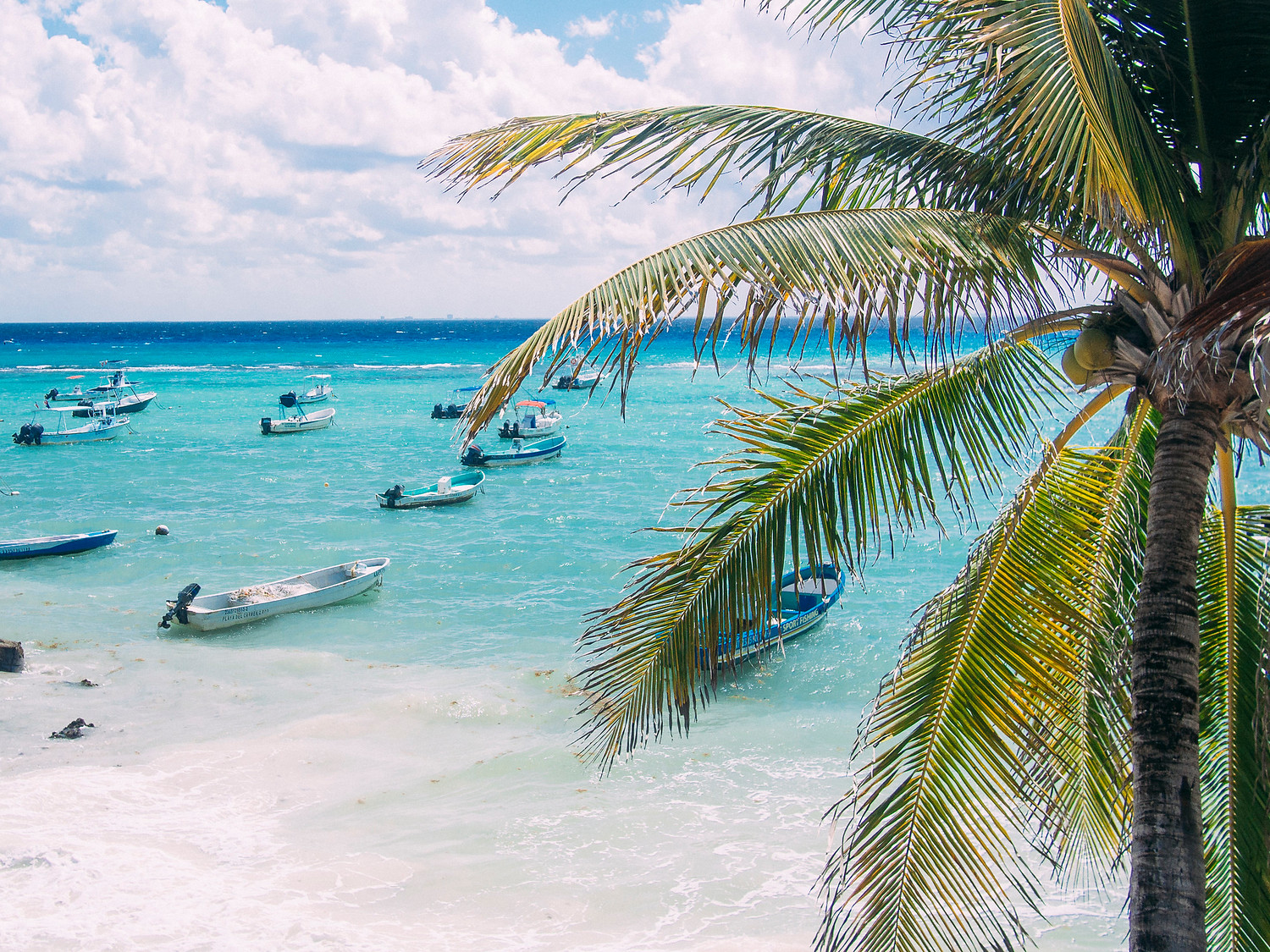 Playa del Carmen beach with boats.
