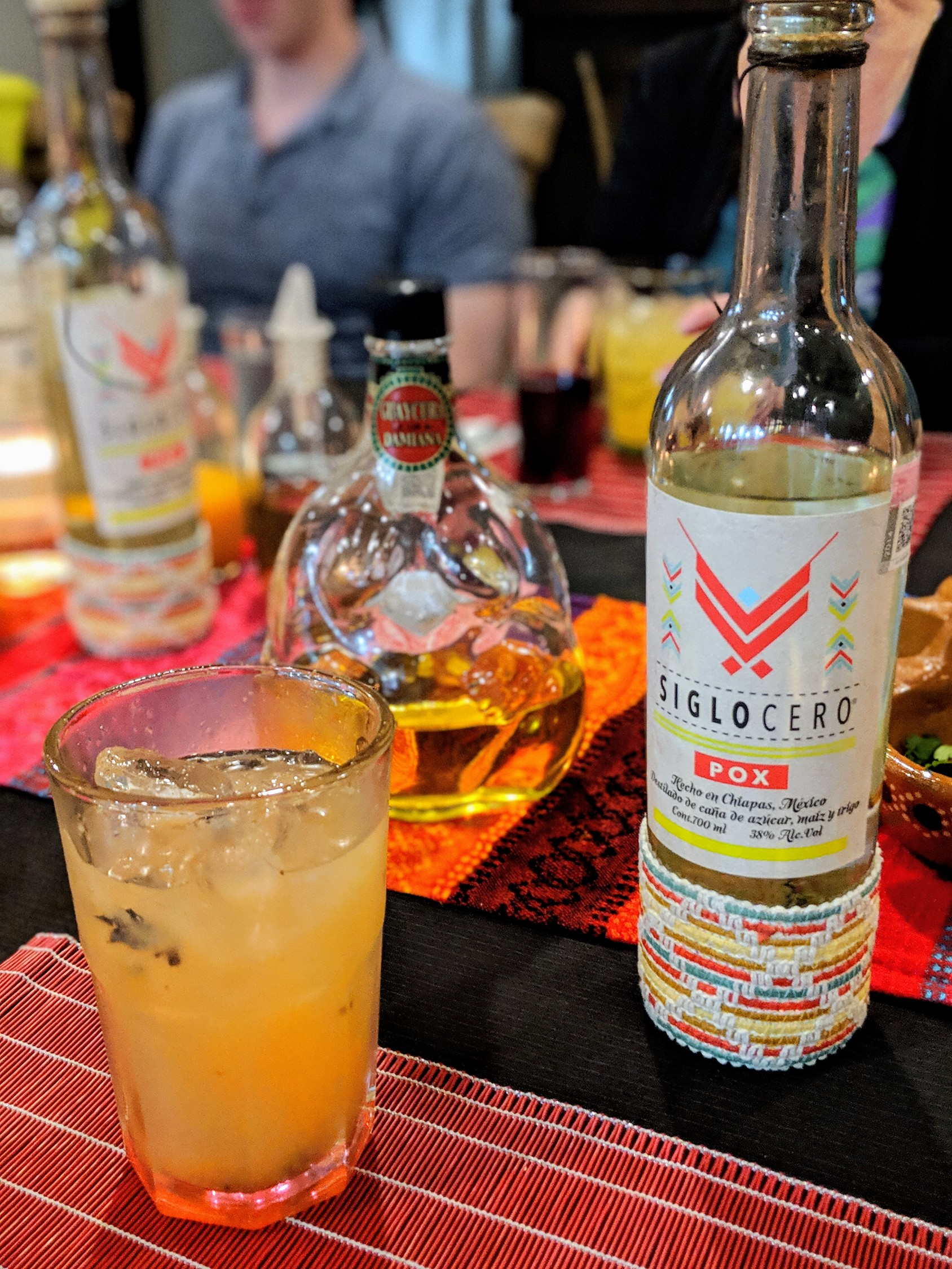 Mexican spirit pox on a table with other cocktails.