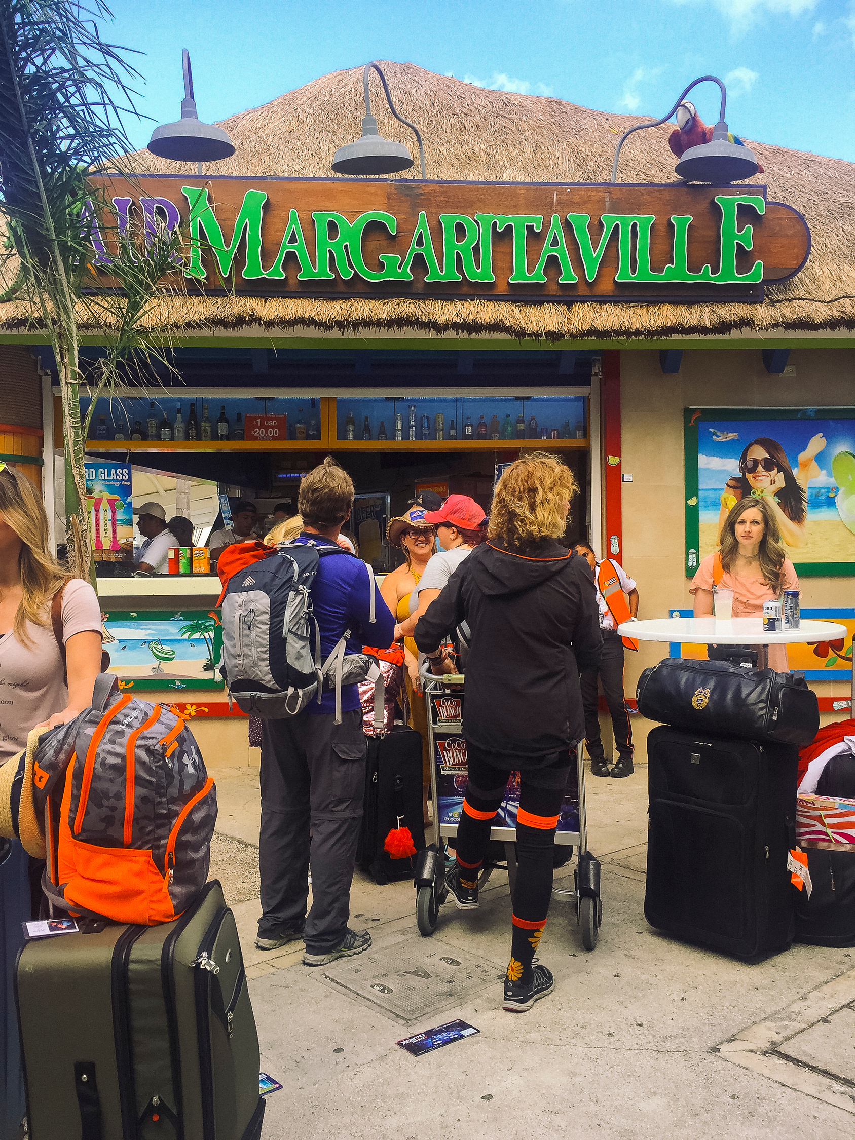 Margaritaville at the Cancun airport is to the right of the exit and on the way to the ADO bus stop.