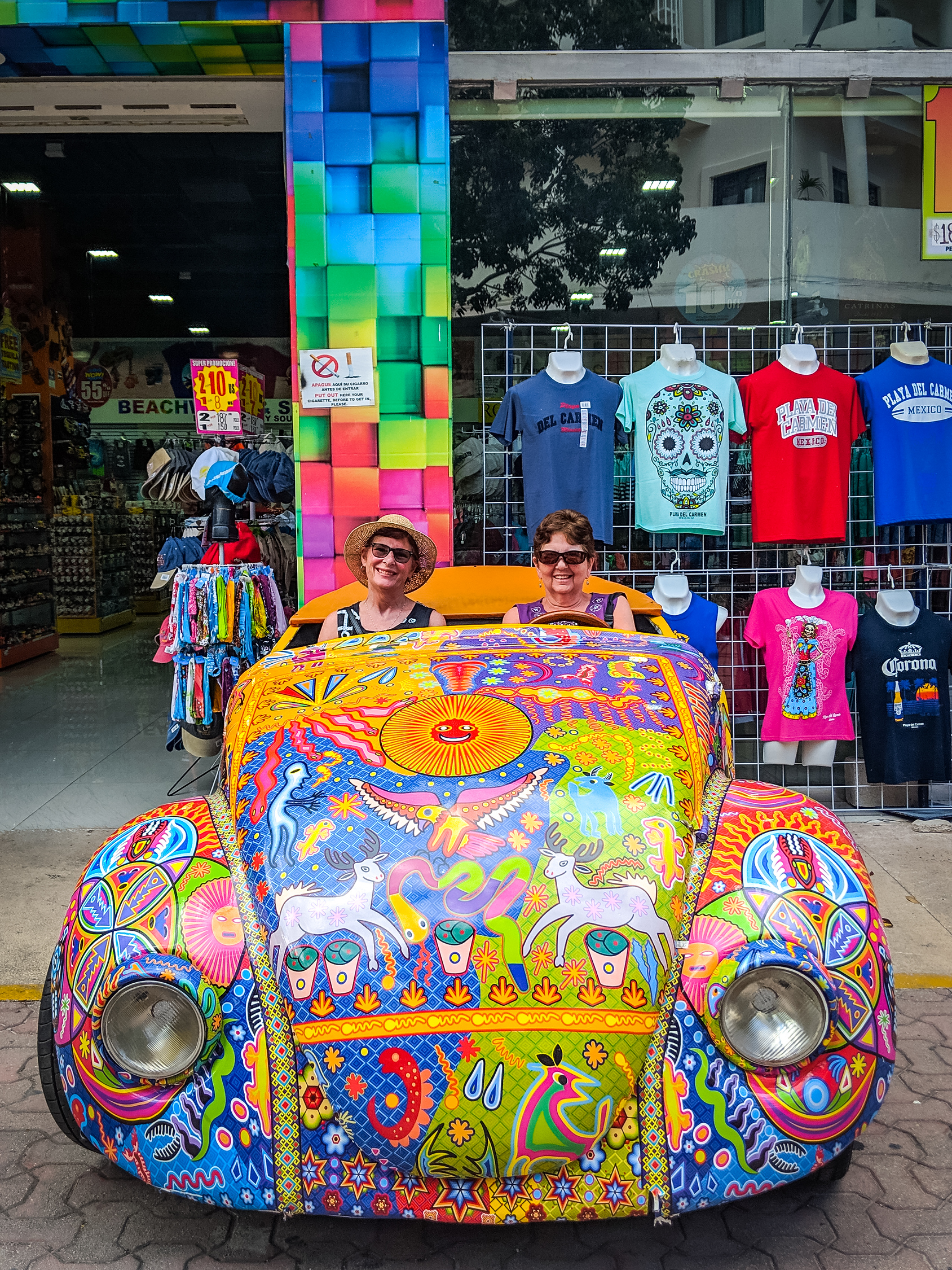 Souvenir shopping in Playa del Carmen Mexico there's a store with a colourful car.