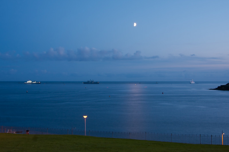 Ships mooring for the evening near the sea wall