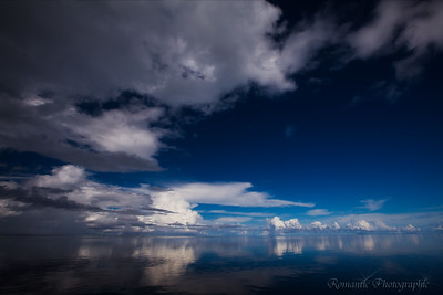 Spectacular sky over a mirror-calm sea.