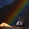 Apparently, the rainbow ends at a large pile of sand.