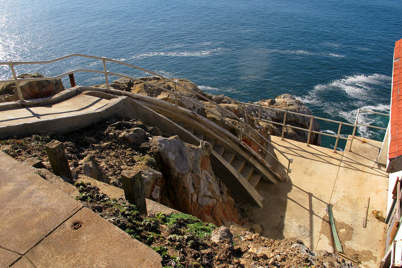 These stairs go down to a small building in front of the lighthouse. This photo was taken from the platform on the lighthouse.