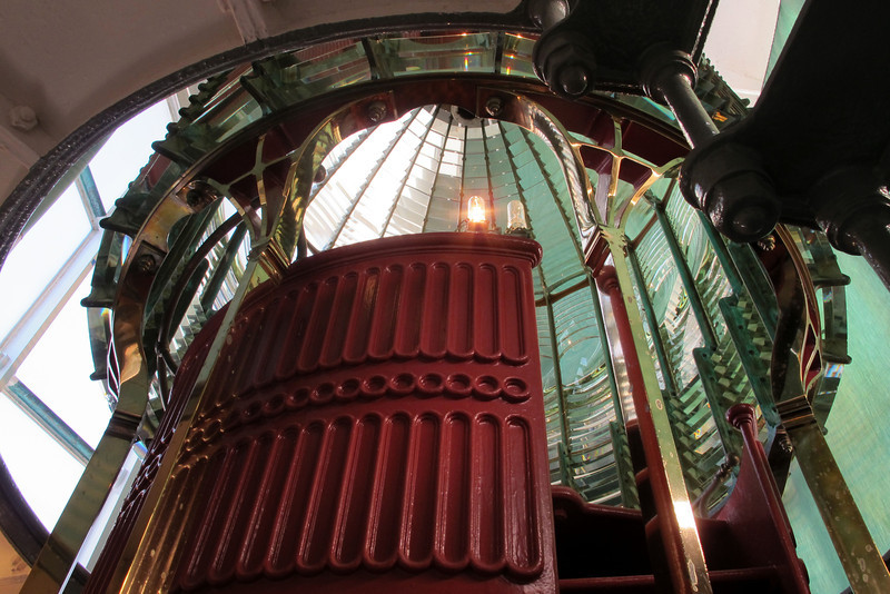 Looking up into the lens in the lighthouse.