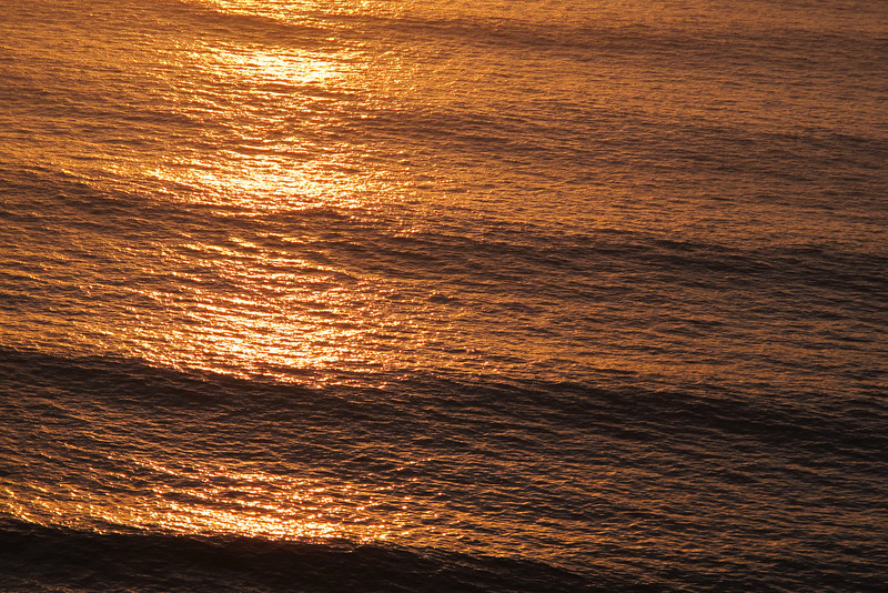 Zoomed in on the gold colored ocean.