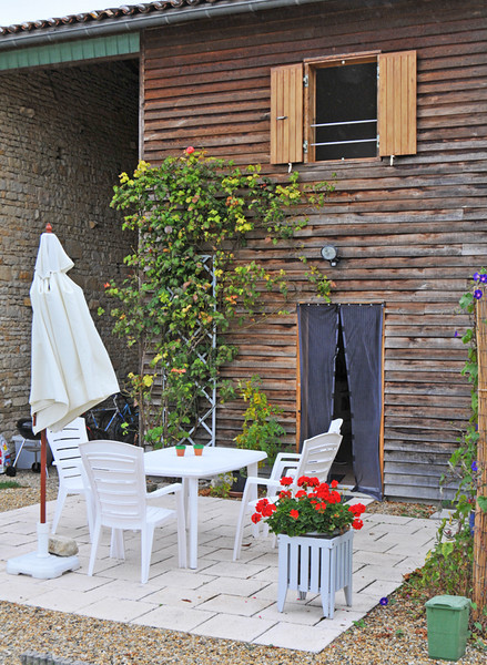 Our very comfortable little gite, Le Chataignier, with a pool, bikes galore, and the all-important  BBQ,