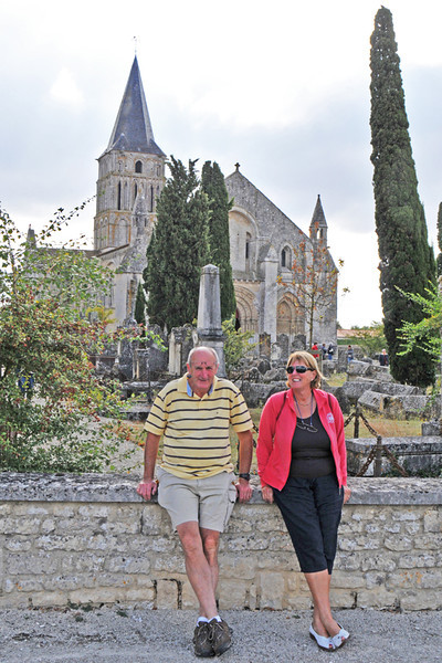 Kevin and sister Carmel propping up the cemetery wall.
