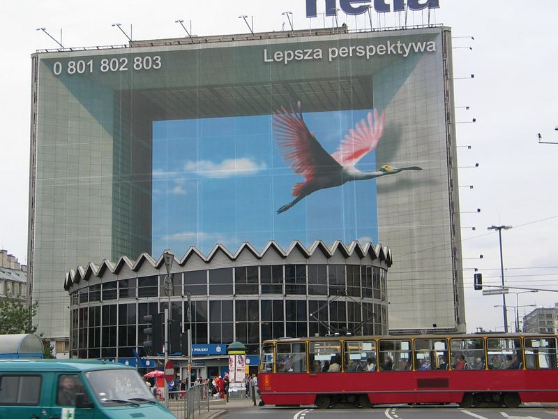 """This is not La Defence in Paris. It is an ad on the side of a building in Warsaw.<br /> Picture take from here: 52d13'49.37"""", 21d0'41.97"""""""