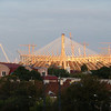 Bridge and new stadium being built on other side of river.