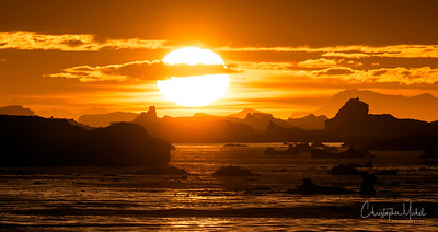 The sun sets over the Iceberg Graveyard in the Lemaire Channel.