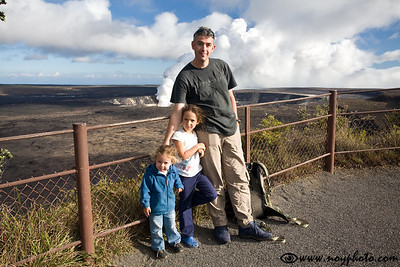 At the Kilauea crater overlook, in the back is the steaming Halema'uma'u crater