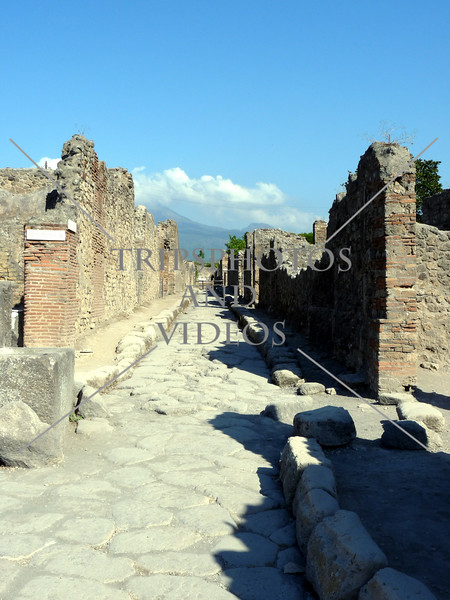 A narrow street in Pompeii ruins in Italy.