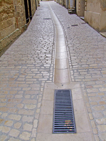 Storm drain system within the streets of Uzes.