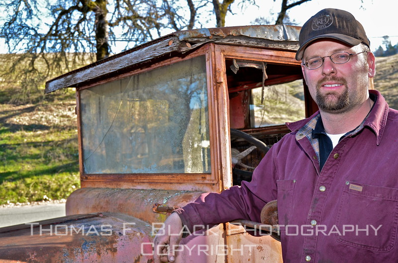 Owner Jeff Parady poses with 1929 Moreland truck, one of several antique vehicles at his auto repair and towing company, Pope Valley, CA, east of saint helena and angwin in Napa Valley wine country. dozens more vintage vehicles sit at his property up the road.  images captured in three separate visits -- 2012, 2016 and 2017. [UFP011212]