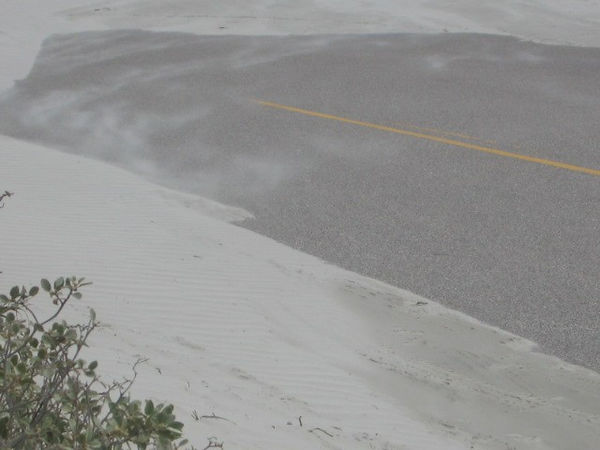 You can see the sand moving in the wind. The next day the city had skiploaders out clearing the sand off the road.