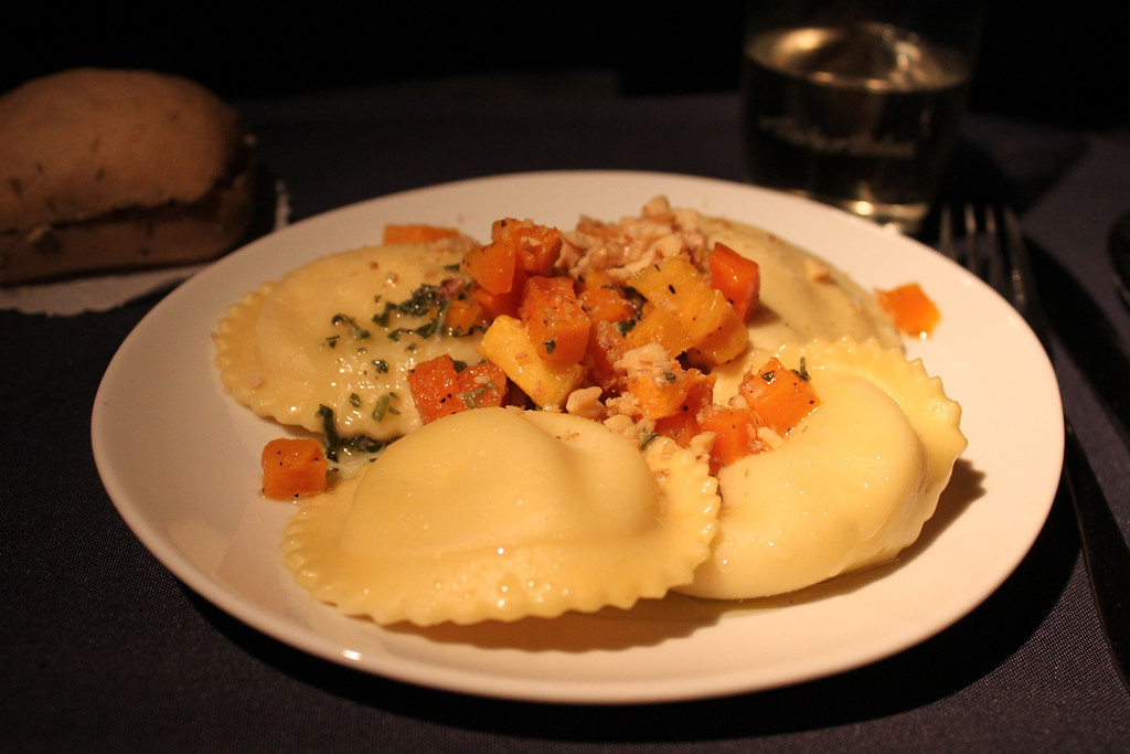 Alaska Airlines First Class Entree. I chose Cheese Ravioli topped with Butternut Squash, Walnuts and a Sage Brown Butter Sauce