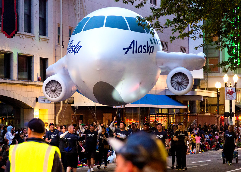 Now we drop in on the Rose Festival's Starlight Parade.  Here comes the Alaska Airlines floating float.