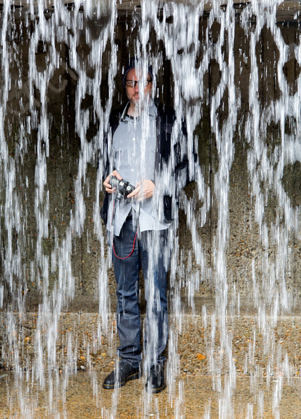 Andrew behind the waterfall.