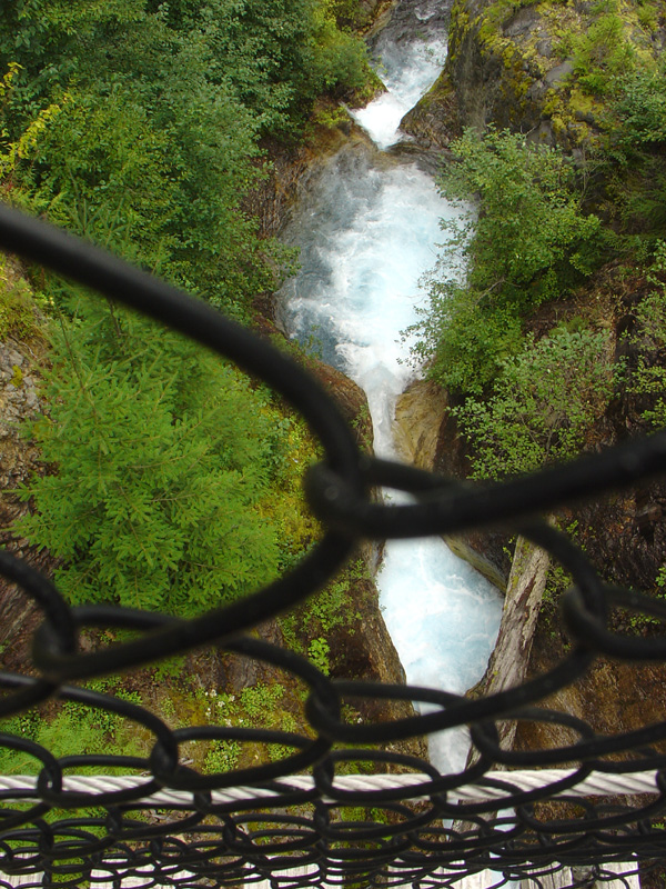 through the fence of the suspension bridge