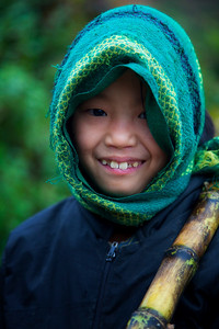 Young girl near homestay in Ta Phin