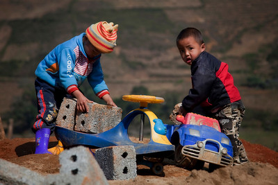 Boys loading bricks near Cat Cat village