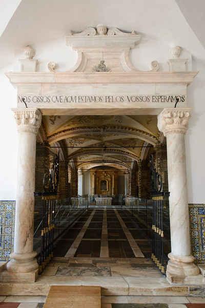 """After a lovely breakfast, we then then started our Wednesday by walking to Évora's Franciscan church.  Above is the entrance to the Capela dos Ossos or Chapel of Bones.  The inscription reads """"We bones that here are, for yours await""""."""