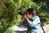 Her new camera has a very long zoom lens that she trained on...