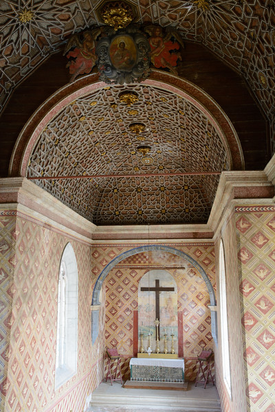 A 15th-century chestnut and oak molded ceiling sets off the private chapel.