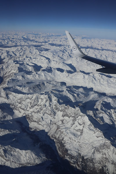 Lufthansa at 25,000 feet over the snow covered Alps heading toward Munich, Germany