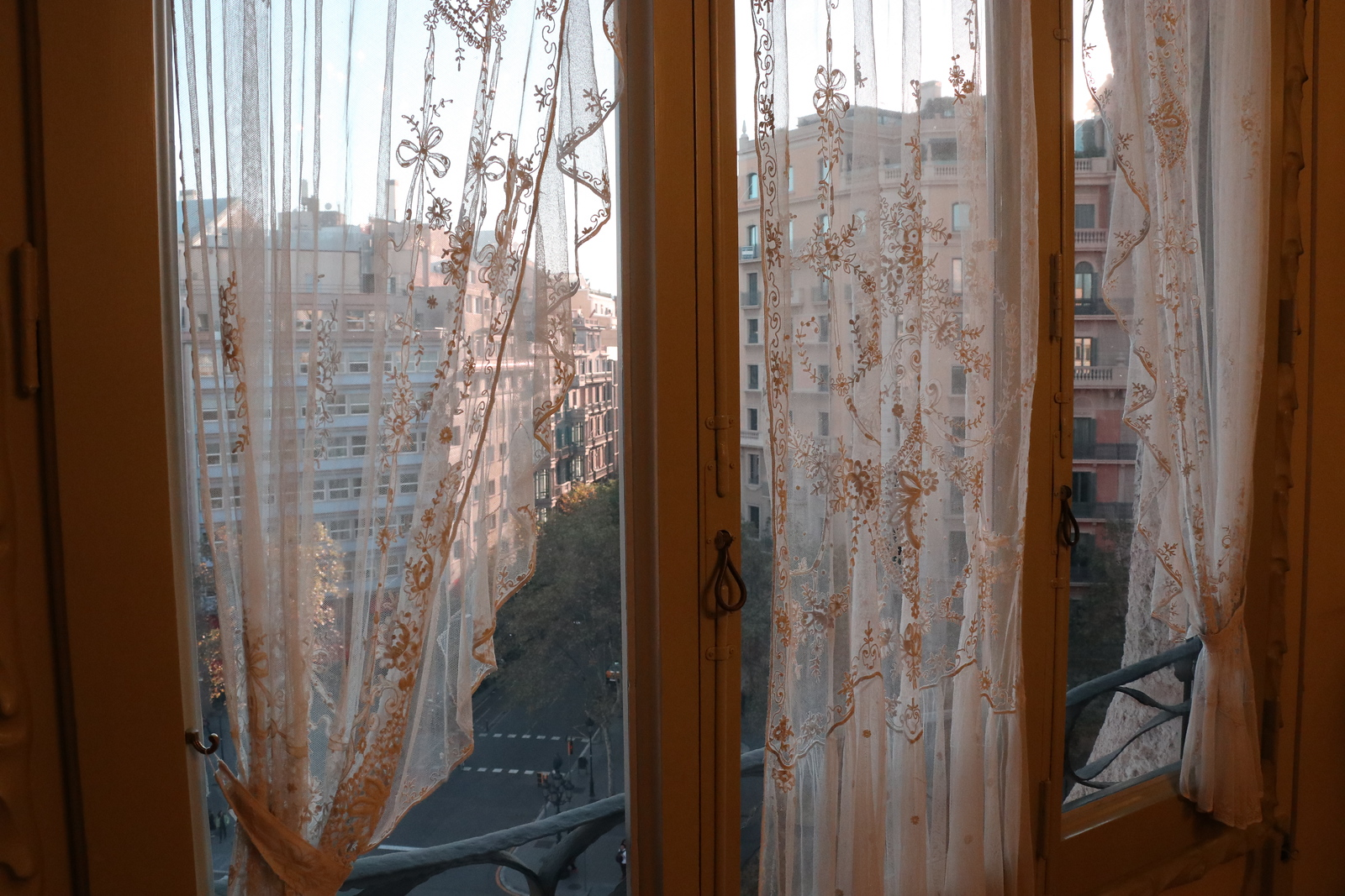 Last evening sun-drenched view through curtains from Antoni Gaudi's La Pedrera