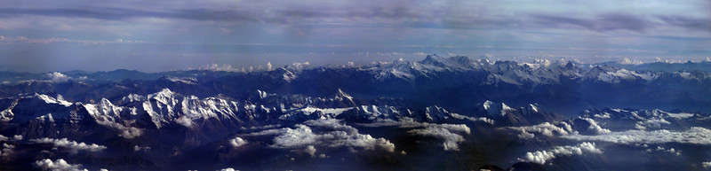 This pano of the Alps was taken at 11000m (36089ft) traveling abut 550 mph or 806 ft/sec. Three images taken from an A319.<br /> I believe I was over Bern, Switzerland. It appears to be the Matterhorn in the center of the picture. The splotchy nature of the sky is not stitching error but polarizing effect of the plastic windows on the plane.