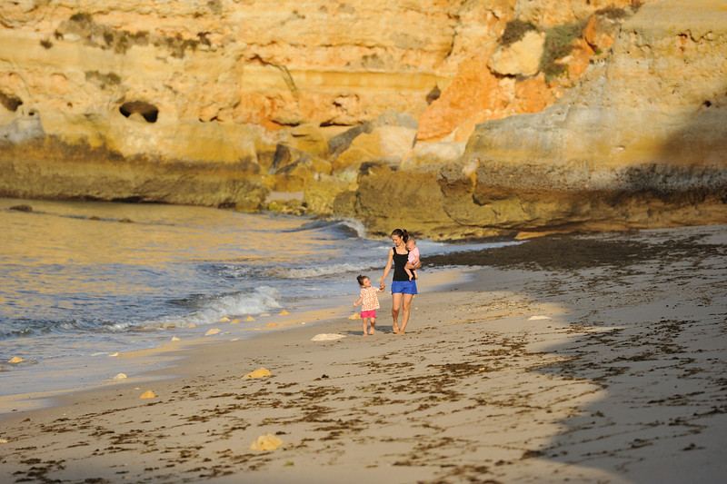 Family playing on Marinha Beach in Algarve Portugal