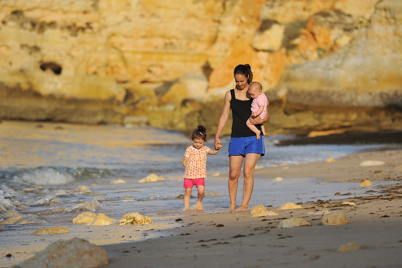 Family walking on Marinha Beach in Algarve Portugal