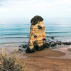 A typical golden sea stack of Praia Dona Ana, Lagos, Algarve.