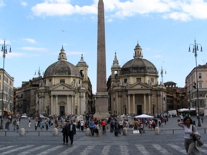 Piazza del Popolo. The obelisk in the center dates back to 1300 BC and was taken from the ancient Egyptian city of Heliopolis. Those are chruches in the background - the Santa Maria in Montesanto on the left and the Santa Maria dei Miracoli on the right.<br /> <br /> This square was featured in the movie Angels and Demons, as the first church of the Illuminati.