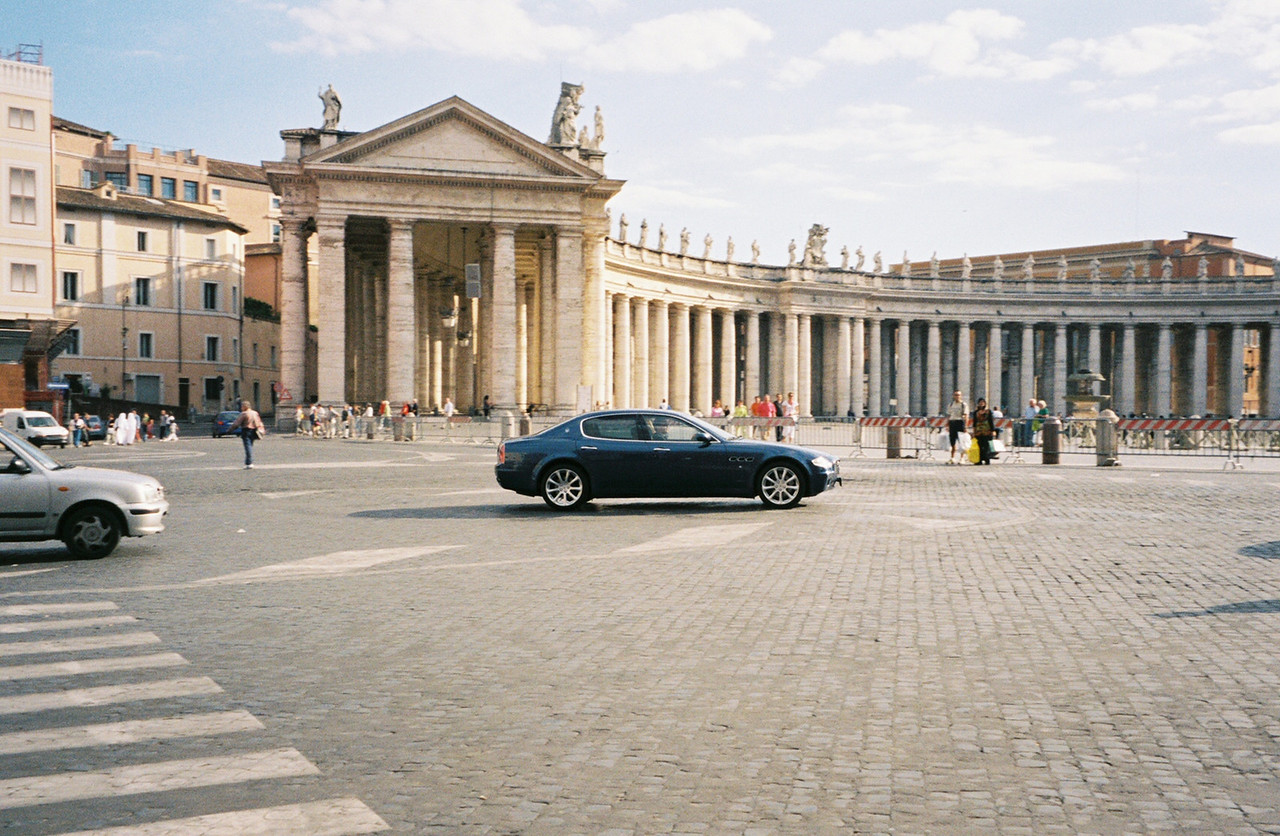 St. Peter's Square. This is a VIP in a new Maserati barrelling through the Square.