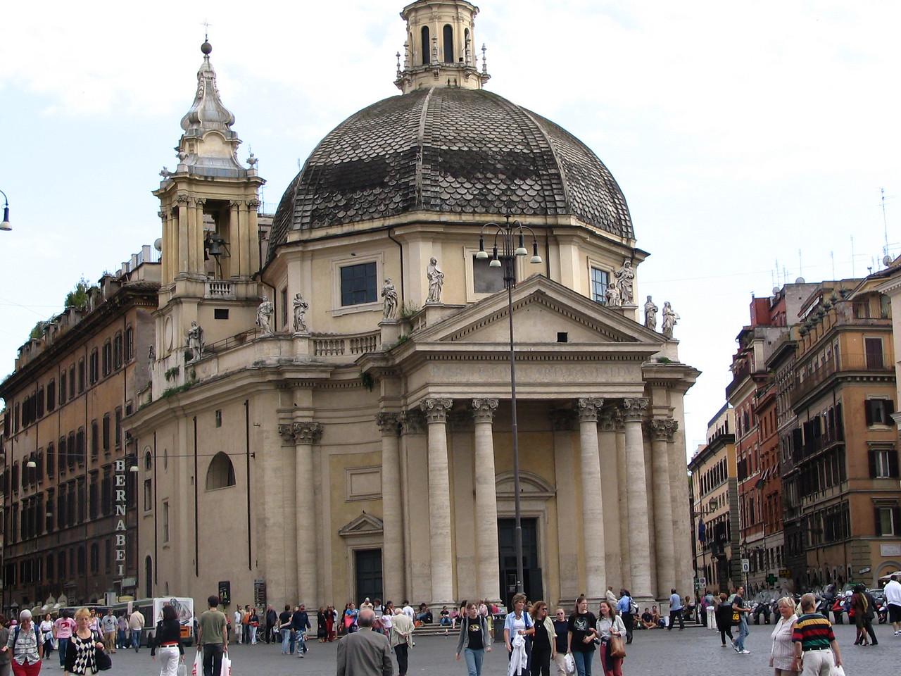 Piazza del Portolo. This is the Santa Maria dei Miracoli church. It was built in 1658 by Carlo Rainaldi.