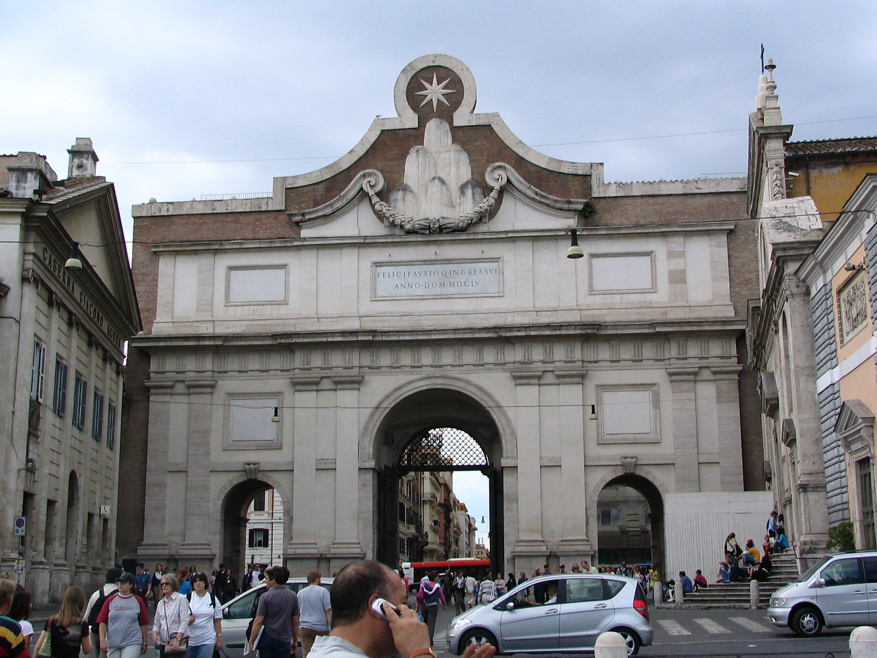 Piazza del Popolo. This is the Porta del Popolo where many immigrants entered the city of Rome since the year 1655. It was built to impress the immigrants on Roman architecture.
