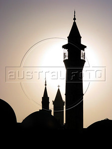 Minarets of a Mosque and the steeple of a church are silouetted in the Beirut, Lebanon skyline.(Australfoto/Douglas Engle)