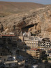 Houses of Maalula, a small town about 50 kilometers (30 miles) from Damascus, Syria, are built into the desert mountainside.(Australfoto/Douglas Engle)