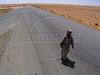 A man walks on the the highway to the Iraqi border in the desert of eastern Syria. The border is closed except for Iraqis and some goods.(Australfoto/Douglas Engle)