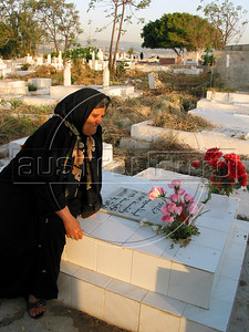 A Moslem women prays at a grave in Tyre, southern Lebanon. Relatives of the deceased pray on their graves as a sign of respect and rememberance.(Australfoto/Douglas Engle)