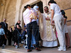 A priest greets worshippers after Catholic mass in the St. Louis Catholic Church in Beirut, Lebanon. Located downtown, an area almost totally destoryed during the 1975-1992 civil war, the church and other historic buildings are almost all totally rebuilt.(Australfoto/Douglas Engle)