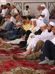 Men wait for the Friday prayer at the Umayyad Mosque in the old city of Damascus, Syria. The mosque is one of the most important buildings of Islam, after mosques in Mecca and Medina in Saudia Arabia.(Australfoto/Douglas Engle)