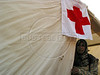 A woman stands outside a Red Cross tent outside of a massive stadium rally in Beirut, Lebanon.(Australfoto/Douglas Engle)