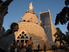 Children play near the statue of the Virgin of Lebanon in Harissa, near Beirut, Lebanon. The statue, with a greek Orthodox chapel in the base, was built in France and moved to Lebanon in the 19th century. The modern Maronite christian cathedral can be seen in the background.(Australfoto/Douglas Engle)