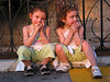 Twins sit outside the Maronite Chapel in Harissa, near Beirut, Lebanon.(Australfoto/Douglas Engle)